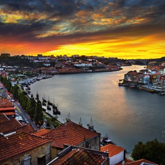 An evening in Porto in early October 2012. I took this from the Ponte Dom Luis I bridge. The bells of Porto's many historic churches ringing and the seagulls signing make the sunsets at this old part of the city absolutely enchanting.